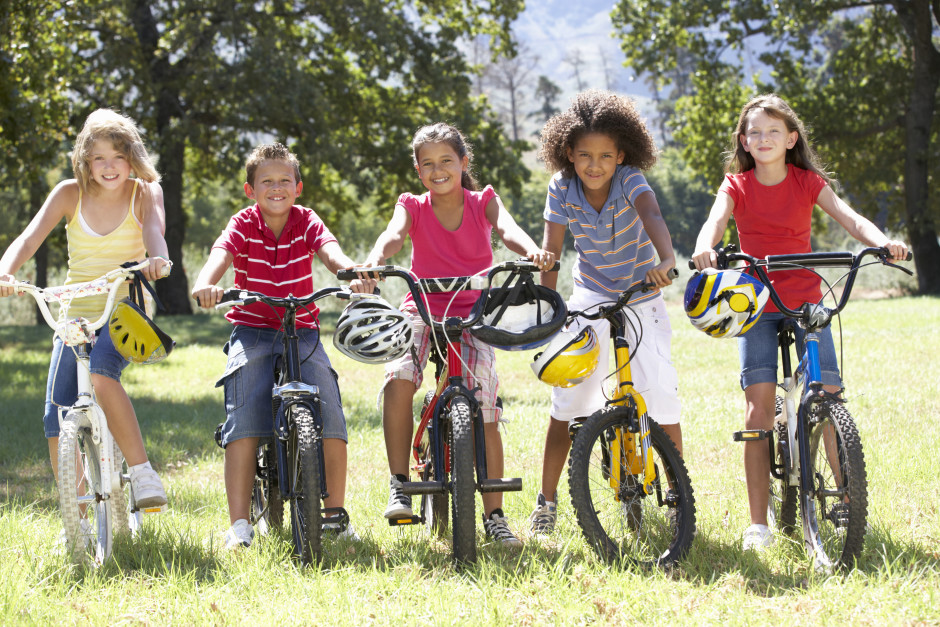 Group Of Children Riding Bikes